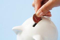 De besparing van het geld Stock Afbeeldingen