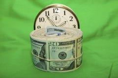 De besparingen van het de tijdgeld van het dollarsbroodje stock afbeelding