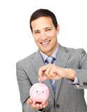 De besparingsgeld van de zakenman in een piggy-bank Stock Foto's