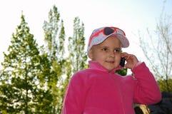 De bespreking van het kind voor telefoon Stock Foto