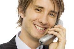 De besprekingen van de zakenman op telefoon Royalty-vrije Stock Afbeeldingen