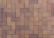 De bestratingsachtergrond van de voetpadstraat met het kleurrijke gecombineerde bedekken royalty-vrije stock afbeelding