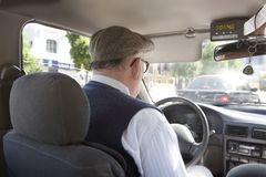 De bestuurder van de taxi Stock Afbeelding