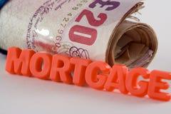 De Betaling van de hypotheek Stock Foto's