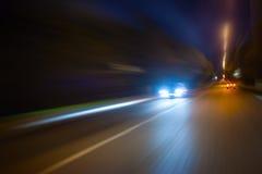 De beweging van de hoge snelheid bij nacht Royalty-vrije Stock Foto