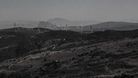 De bewolkte elektriciteit van het windmolengebied Royalty-vrije Stock Afbeelding