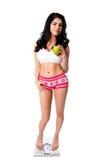 De bewuste vrouw van het gewicht met appel Royalty-vrije Stock Foto