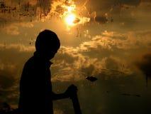 De Bezinningen van de zonsondergang Stock Foto