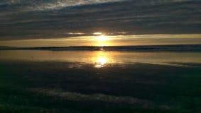 De Bezinningen van het zonsondergangzand Stock Afbeeldingen
