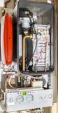 De binnenwerkingen van een het Condenseren of Combi-Boiler Stock Foto