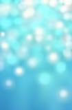 De blauwe abstracte bokehachtergrond met defocused lichten, Kerstmis Stock Fotografie