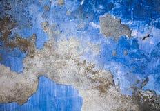 De blauwe achtergrond van de grungemuur Stock Foto's
