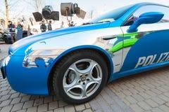 De blauwe auto van Afla Romeo Brera met zilveren schilderijenlijnen Stock Foto