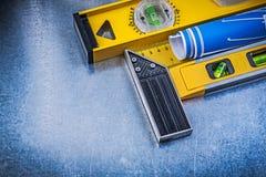 De blauwe blokhaak van de bouwniveaus van techniektekeningen op meta Royalty-vrije Stock Afbeeldingen