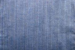 De blauwe corduroy achtergrond van de het close-upfoto van de stoffentextuur Royalty-vrije Stock Fotografie