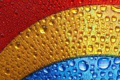 De blauwe dalingen van het gouden en rode kleuren abstracte water Royalty-vrije Stock Fotografie