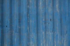De blauwe geschilderde achtergrond van het metaalblad stock foto's