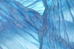 De blauwe Golvende Achtergrond van de Stoffentextuur Stock Fotografie