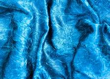 De blauwe golvende textuur van de satijnstof Royalty-vrije Stock Foto's