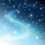 De blauwe hemel van de winter met sneeuwvlokken en sterren Royalty-vrije Stock Foto