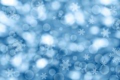 De blauwe lichte achtergrond van Kerstmis Stock Afbeeldingen