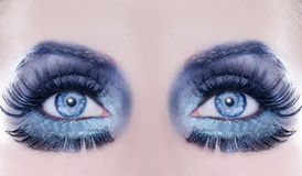 De blauwe make-up van de de fantasiemanier van de ogen macroclose-up stock afbeeldingen