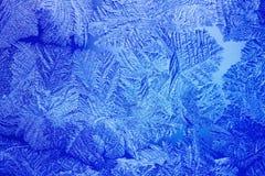 De blauwe patronen van het Ijs die door de vorst worden gemaakt Stock Fotografie