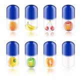 De blauwe pil van de inzameling met fruit Stock Afbeeldingen