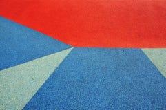 De blauwe, rode en grijze oppervlakten van de sportengronden royalty-vrije stock foto's