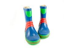 De blauwe rubberlaarzen van Childs Stock Afbeeldingen