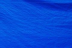 De blauwe textuur van de geteerde zeildoekenstof Stock Foto