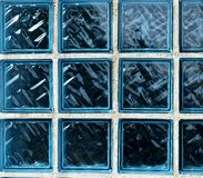 De blauwe textuur van glasbakstenen Blauwe bakstenenachtergrond Witte lijnen stock foto
