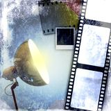 De blauwe uitstekende achtergrond van de filmstrook en geleide reflector Royalty-vrije Stock Foto