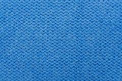 De blauwe wollen breiende achtergrond van de stoffentextuur Royalty-vrije Stock Afbeelding