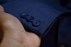 De blauwe zwarte textuur van de de knoopclose-up van blazerkokers royalty-vrije stock foto