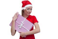 De blije helper van de Kerstman met roze huidige doos Royalty-vrije Stock Foto's
