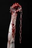De bloedige keten van de handholding, bloedige ketting, Halloween-thema, zwarte geïsoleerde achtergrond, Stock Fotografie
