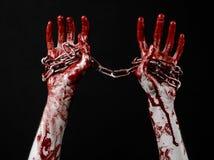 De bloedige keten van de handholding, bloedige ketting, Halloween-thema, zwarte geïsoleerde achtergrond, Stock Afbeelding