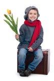 De bloemen van de de holdingstulp van de jongen Stock Afbeelding