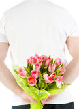 De Bloemen van de Holding van de hand Stock Afbeeldingen
