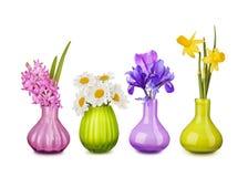De bloemen van de lente in vazen stock foto
