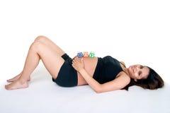 De Blokken van de baby op Maag Stock Foto's