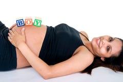 De Blokken van de baby op Maag Stock Afbeeldingen