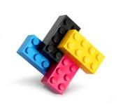 De blokken van de kleurenlego van Cmyk stock foto's