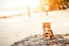 Is de Blokken van hout op de steen en het zand stock afbeelding