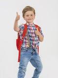 De blonde jongen begroet met omhoog duim royalty-vrije stock afbeelding