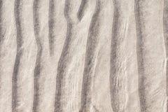De bodem van een zandig strand Stock Afbeeldingen