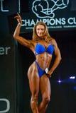 De Bodybuildingskampioenen vormen tot een kom Stock Foto's