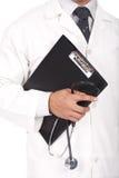 De boeken van de de holdingsnota van de arts en stetoscope Stock Foto's