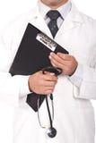 De boeken van de de holdingsnota van de arts en stetoscope Royalty-vrije Stock Afbeelding